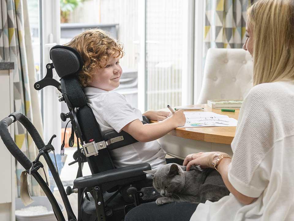 Little boy in an electric wheelchair
